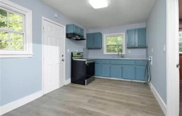4 Bedroom Home with Beautiful Hardwood Floors in Booming Neighbourhood